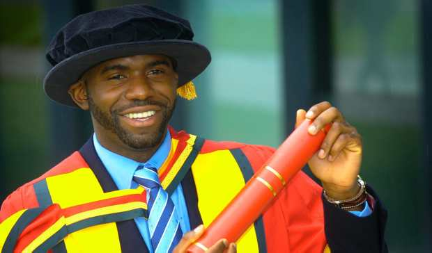 Fabrice Muamba, in graduate attire, collects his doctorate from the University of Bolton (c) Manchester Evening News