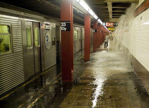 Subterranean floodwater poses a challenge to the few commuters prepared to face down Sandy's wrath. (c) International Business Times