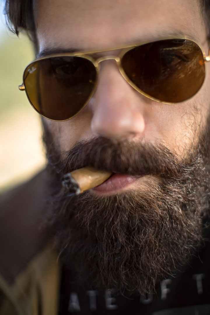 close up photo of man smoking cigar