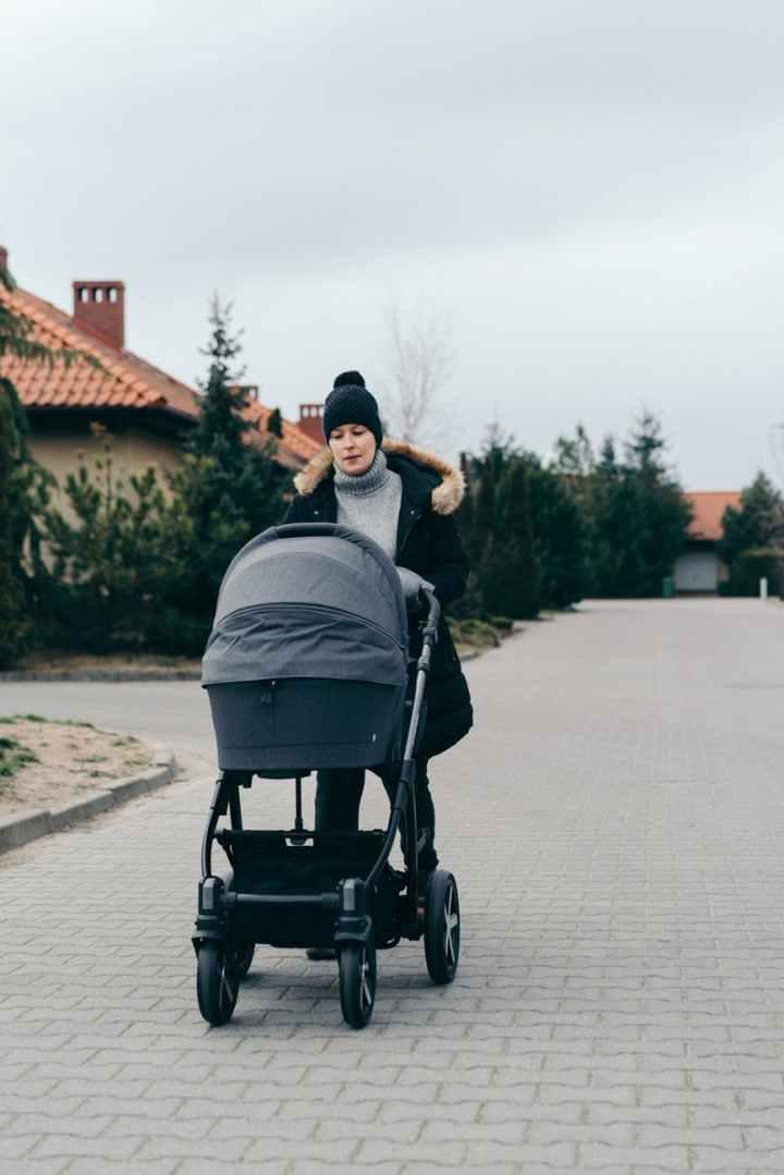 woman pushing stroller