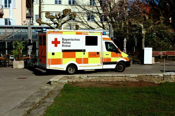 ambulance truck parked near building